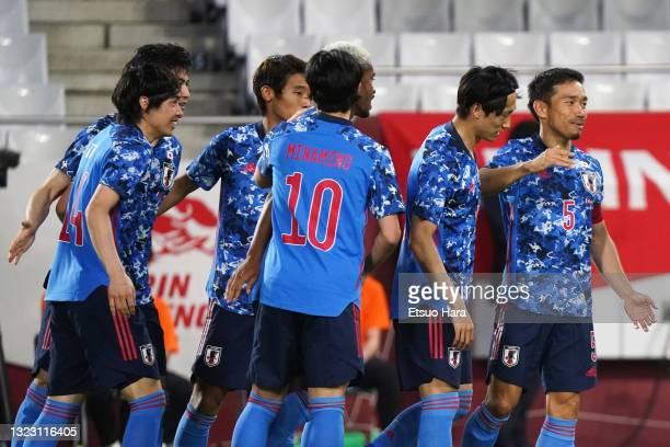 Junya Ito of Japan celebrates scoring his side's first goal during the international friendly match between Japan and Serbia at Noevir Stadium Kobe...