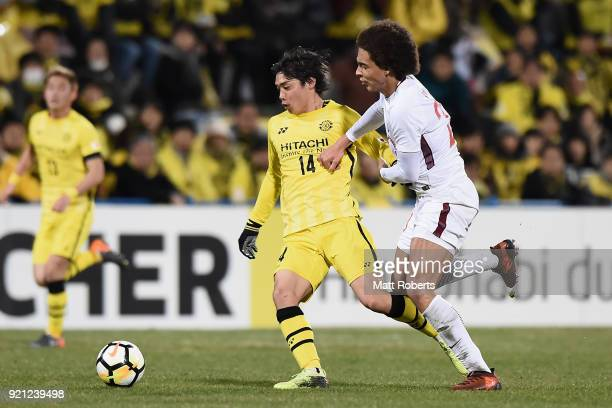 Junya Ito of Kashiwa Reysol and Axel Witsel of Tianjin Quanjian compete for the ball during the AFC Champions League match between Kasshiwa Reysol...