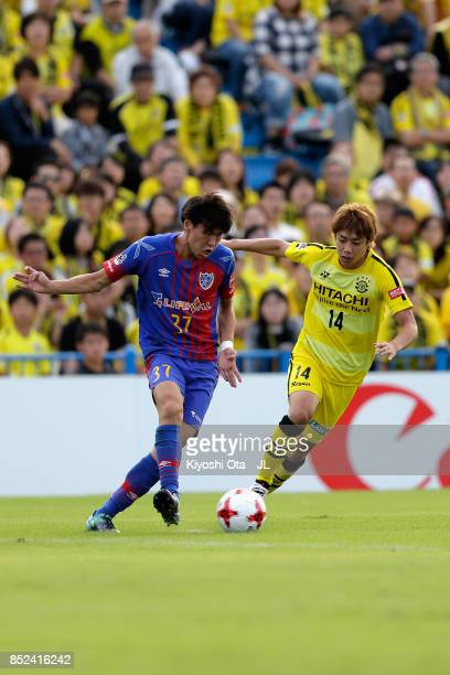Junya Ito of Kashiwa Reysol and Kento Hashimoto of FC Tokyo compete for the ball during the JLeague J1 match between Kashiwa Reysol and FC Tokyo at...