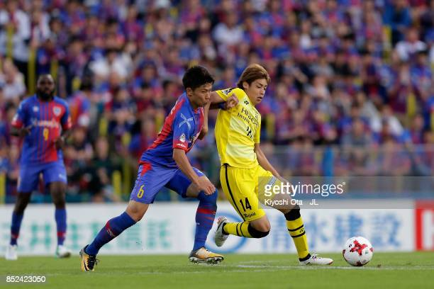 Junya Ito of Kashiwa Reysol and Kosuke Ota of FC Tokyo compete for the ball during the JLeague J1 match between Kashiwa Reysol and FC Tokyo at...