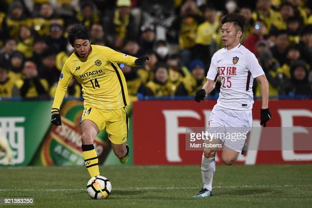 Junya Ito of Kashiwa Reysol and Mi Haolun of Tianjin Quanjian compete for the ball during the AFC Champions League match between Kasshiwa Reysol and...