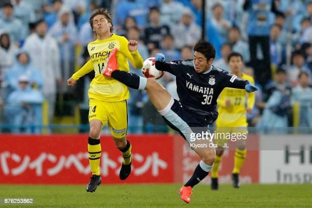 Junya Ito of Kashiwa Reysol and Rikiya Uehara of Jubilo Iwata compete for the ball during the J.League J1 match between Kashiwa Reysol and Jubilo...