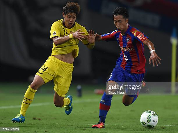 Junya Ito of Kashiwa Reysol and Sei Muroya of FC Tokyo compete for the ball during the JLeague match between FC Tokyo and Kashiwa Reysol at the...
