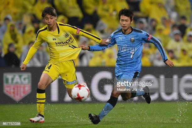Junya Ito of Kashiwa Reysol and Shintaro Kurumaya of Kawasaki Frontale compete for the ball during the JLeague J1 match between Kashiwa Reysol and...