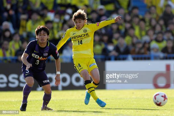 Junya Ito of Kashiwa Reysol and Soya Takahashi of Sanfrecce Hiroshima compete for the ball during the JLeague J1 match between Kashiwa Reysol and...
