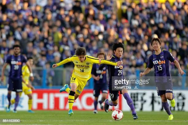Junya Ito of Kashiwa Reysol and Tsukasa Morishima of Sanfrecce Hiroshima compete for the ball during the JLeague J1 match between Kashiwa Reysol and...
