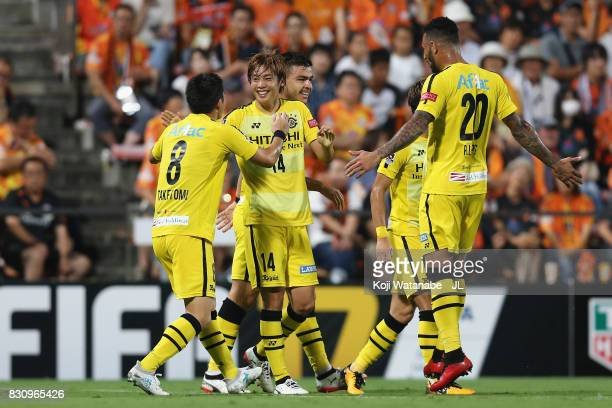 Junya Ito of Kashiwa Reysol celebrates scoring the opening goal with his team mates during the JLeague J1 match between Shimizu SPulse and Kashiwa...