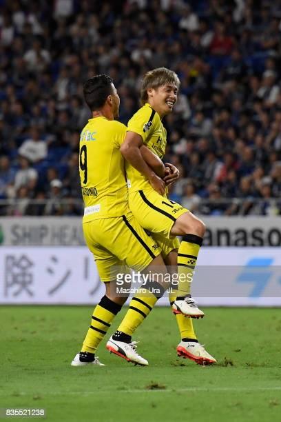 Junya Ito of Kashiwa Reysol celebrates scoring the opening goal with his team mate Cristiano during the JLeague J1 match between Gamba Osaka and...