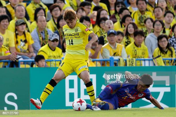 Junya Ito of Kashiwa Reysol Kosuke Ota of FC Tokyo compete for the ball during the JLeague J1 match between Kashiwa Reysol and FC Tokyo at Hitachi...