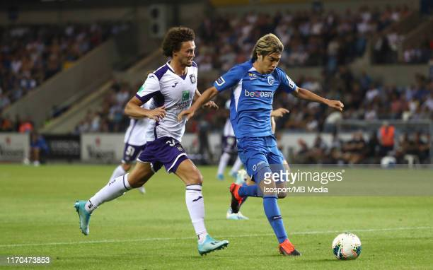 Junya Ito of Krc Genk battles for the ball with Philippe Sandler of Anderlecht during the Jupiler Pro League match between KRC Genk and RSC...