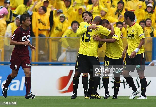 Junya Tanaka of Kashiwa Reysol celebrates first goal with teammate Leandro Domingues and Hideaki Kitajima during JLeague match between Kashiwa Reysol...