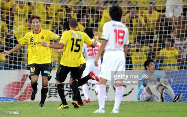 Junya Tanaka of Kashiwa Reysol celebrates the first goal with his teammate Jorge Wagner during J.League match between Kashiwa Reysol and Nagoya...