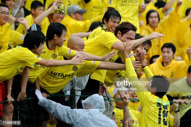 Junya Tanaka of Kashiwa Reysol celebrates with fans after scoring his team's second goal during the J.League match between Kashiwa Reysol and Vissel...