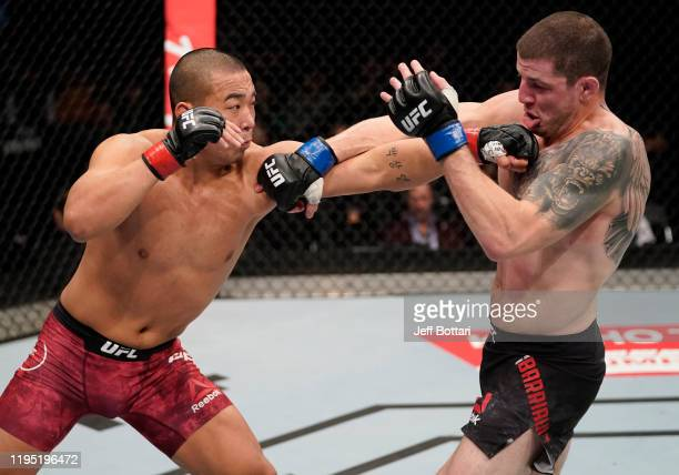 Junyong Park of South Korea punches MarcAndre Barriault of Canada in their middleweight fight during the UFC Fight Night event at Sajik Arena 3 on...
