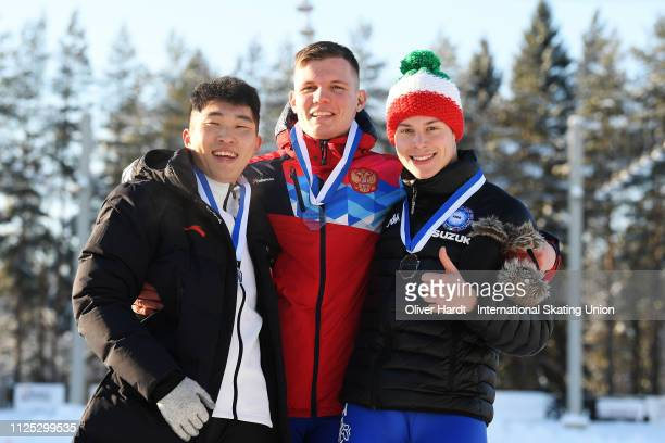 Junzhi Zhang of China with the bronze medal Ruslan Zakharov of Russia with the gold medal and Jeffrey Rosanelli of Italy with the silver medal...
