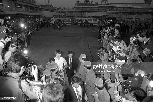 Junzo Okudaira is taken to a chartered airplane as he is released and transferred at Haneda Airport on October 1 1977 in Tokyo Japan Five members of...
