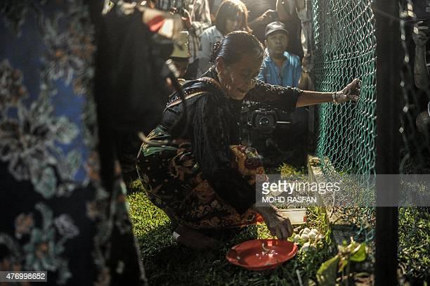 Jupirin Gombur a shaman from the KadazanDusun tribe offers prayers during the Monolibabow rituals in Damat in the district of Tamparuli in Malaysia's...