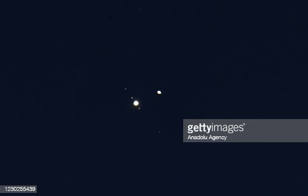 Jupiter and Saturn form double planet in night sky in event known as great conjunction in Burnsville, NC United States on December 21, 2020