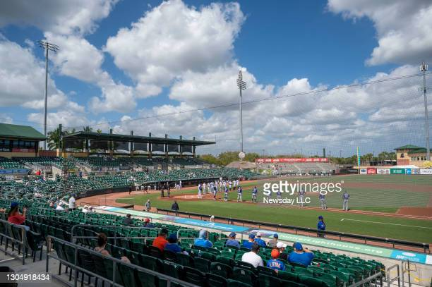 Players are introduced at the start of a spring training game between the New York Mets and the Miami Marlins at Roger Dean Chevrolet Stadium in...