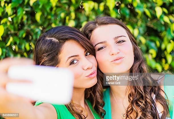 USA, Jupiter, Florida, Portrait of female friends (14-15) making selfie