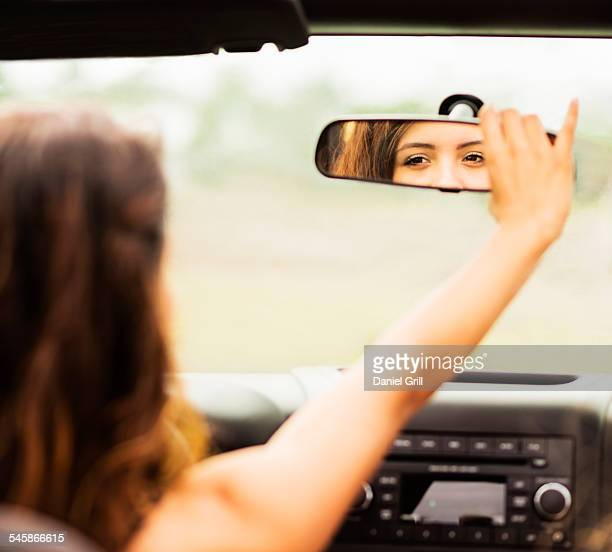 USA, Jupiter, Florida, Reflection of young woman in rear view mirror