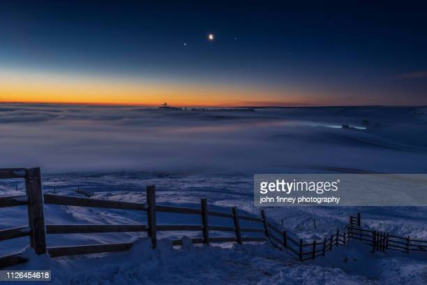jupiter, venus, moon conjunction over freezing fog and snow. peak district. uk - venus planet stock pictures, royalty-free photos & images