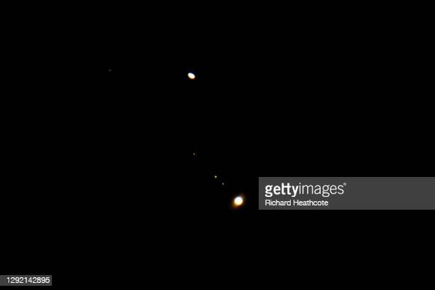 Jupiter, with it's moons, and Saturn are seen in close proximity to each other on December 19th, 2020 in High Wycombe, England. Jupiter and Saturn...