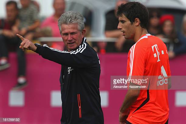 Jupp Henyckes head coach of Bayern Muenchen talks to his player Javier Martínez during a FC Bayern Muenchen training session at the Saebener Strasse...