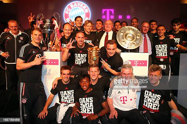 Jupp Henyckes head coach of FC Bayern Muenchen poses with his team during Champions party after winning the German DFB Cup finale at Deutsche Telekom...