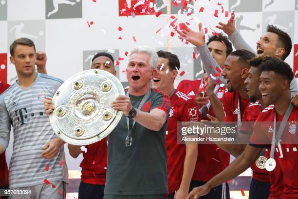 Jupp Heynckes coach of Bayern Muenchen lifts the Bundesliga trophy following the Bundesliga match between FC Bayern Muenchen and VfB Stuttgart at...