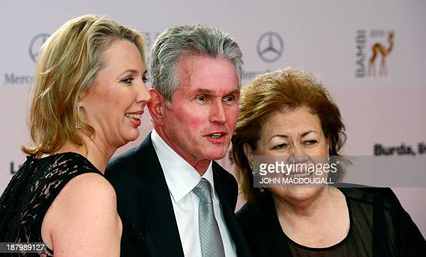 Jupp Heynckes former trainer of Bayern Munich and his wife Iris and daughter Kerstin pose for photographers on the red carpet as they arrive for the...