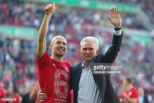 Jupp Heynckes head coach of Bayern Muechen celebrates in front of their supporters with Arjen Robben of Bayern Muenchen after the Bundesliga match...