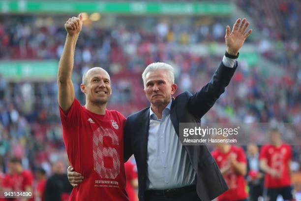Jupp Heynckes, head coach of Bayern Muechen, celebrates in front of their supporters with Arjen Robben of Bayern Muenchen winning the 6th...