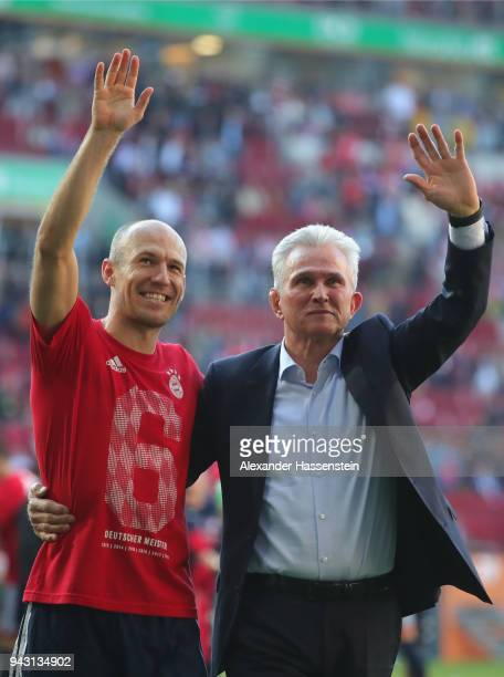 Jupp Heynckes head coach of Bayern Muechen celebrates in front of their supporters with Arjen Robben of Bayern Muenchen winning the 6th championship...