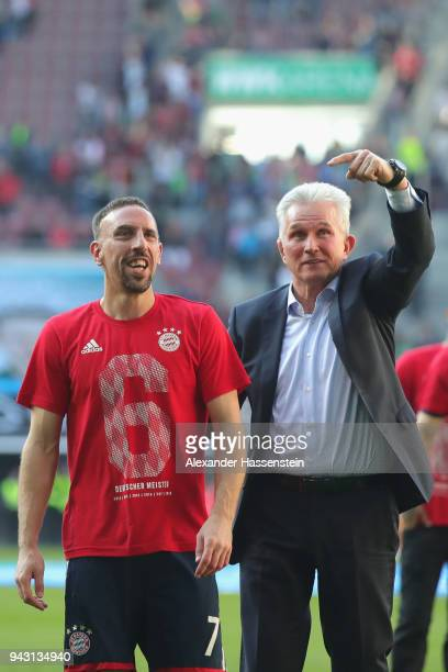 Jupp Heynckes head coach of Bayern Muechen celebrates in front of their supporters with Franck Ribery of Bayern Muenchen winning the 6th championship...