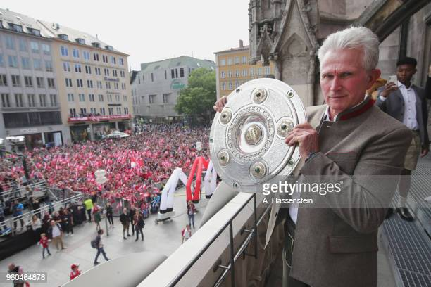 Jupp Heynckes head coach of Bayern Muenchen celebrates winning the German Championship title on the town hall balcony at Marienplatz on May 20 2018...