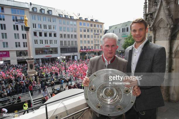 Jupp Heynckes, head coach of Bayern Muenchen celebrates winning the German Championship title with his keeper Manuel Neuer on the town hall balcony...