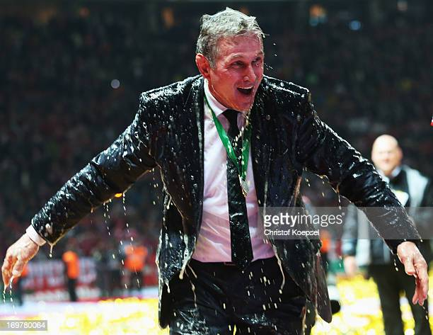 Jupp Heynckes head coach of Bayern Muenchen is showered with beer as celebrates victory in his last match after the DFB Cup Final match between FC...