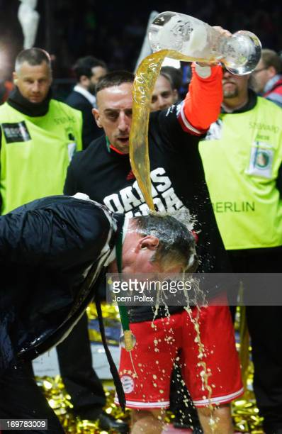 Jupp Heynckes head coach of Bayern Muenchen is showered with beer by Franck Ribery as he celebrates victory in his last match after the DFB Cup Final...