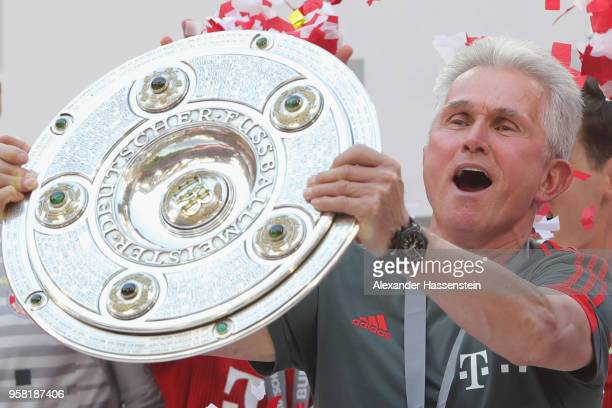 Jupp Heynckes head coach of Bayern Muenchen lifts the trophy in Celebration for winning the German Championship title after the Bundesliga match...