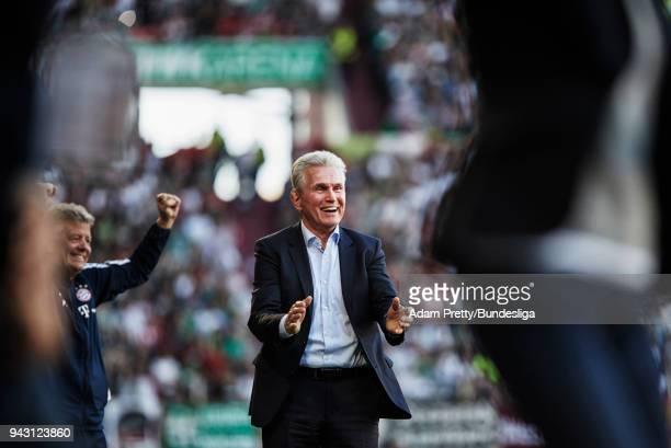 Jupp Heynckes head coach of Bayern Munich celebrates after Arjen Robben of Bayern Munich scored the third goal in the Bundesliga match between FC...