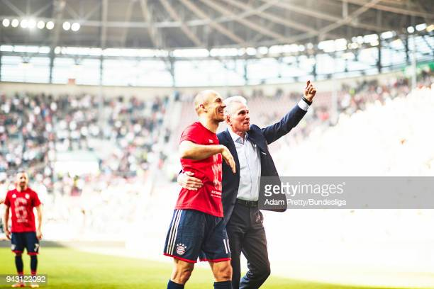 Jupp Heynckes head coach of Bayern Munich celebrates with Arjen Robben of Bayern Munich after victory in the Bundesliga match between FC Augsburg and...