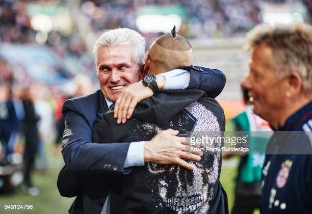Jupp Heynckes head coach of Bayern Munich celebrates with Arturo Vidal of Bayern Munich after victory in the Bundesliga match between FC Augsburg and...