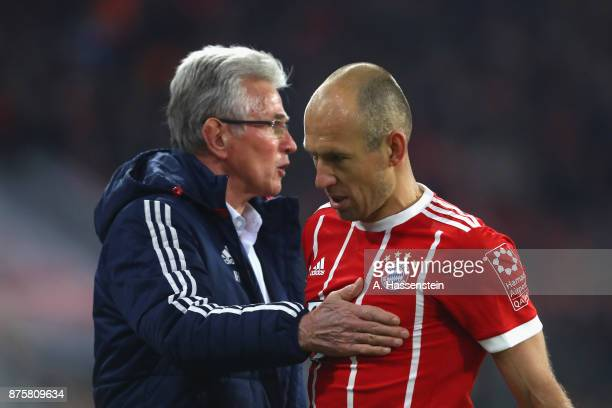 Jupp Heynckes head coach of FC Bayern Muenchen reacts with his player Arjen Robben during the Bundesliga match between FC Bayern Muenchen and FC...