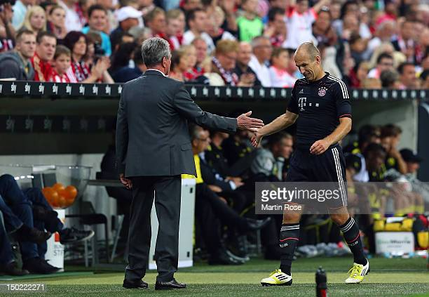 Jupp Heynckes head coach of Muenchen shakes hands with Arjen Robben of Muenchen during the Bundesliga Supercup 2012 match between Bayern Muenchen and...