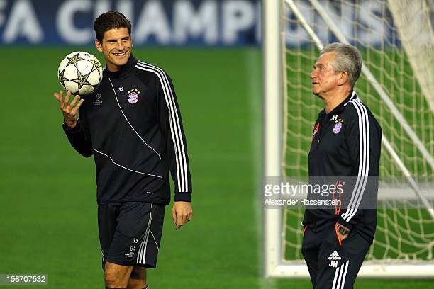Jupp Heynckes head coach of Muenchen talks to his player Mario Gomez during a FC Bayern Muenchen training session ahead of their UEFA Champions...