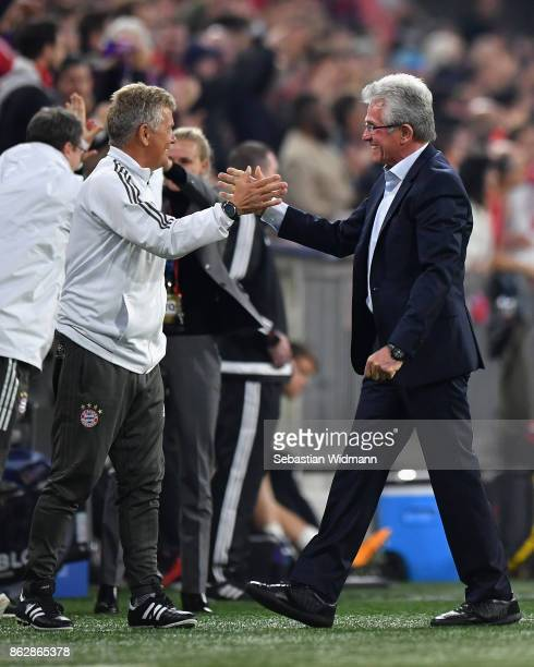 Jupp Heynckes Manager of Bayern Muenchen celebrates his sides first goal with his coaching staff during the UEFA Champions League group B match...