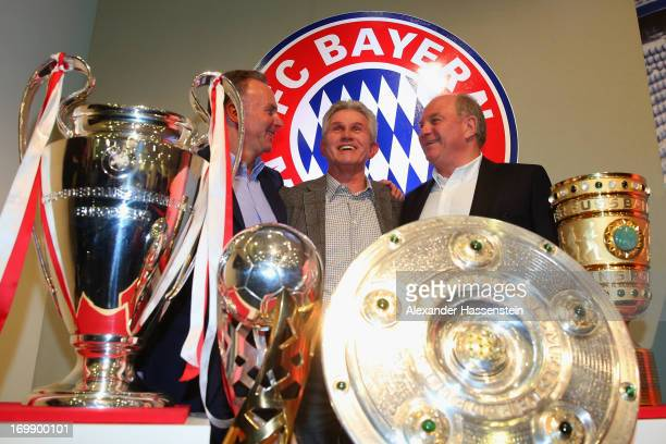Jupp Heynckes of FC Bayern Muenchen poses with Uli Hoeness , President of FC Bayern Muenchen and Karl-Heinz Rummenigge, CEO of FC Bayern Muenchen and...