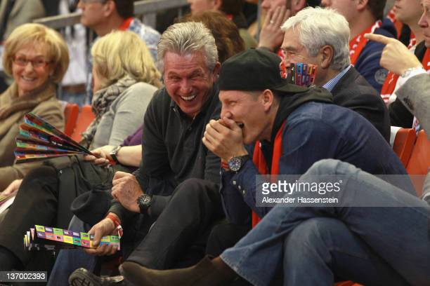 Jupp Heynckes soccer head coach of FC Bayern Muenchen smiles with his player Bastian Schweinsteiger during the Beko Basketball match between FC...