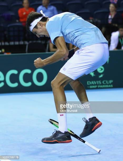 Jurabek Karimov of Uzbekistan celebrates match point against Cameron Norrie of Great Britain during day one of the Davis Cup match between Great...